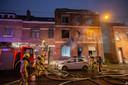 De bewoonster werd door de brandweer langs het raam geëvacueerd.