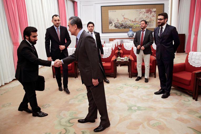 De Chinese minister van buitenlandse zaken Wang Yi op bezoek in Afghanistan, begin 2019. Beeld Getty Images