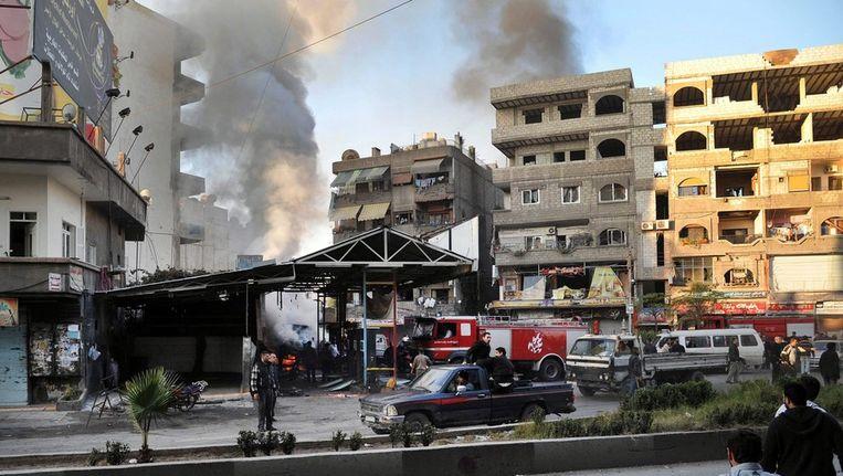 De buitenwijk Jaramana na de bomaanslag vandaag. Beeld epa