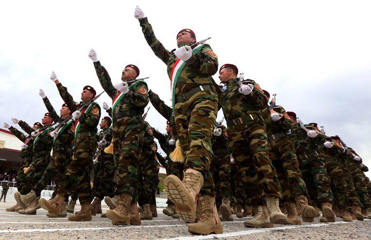 Iraakse militairen in de buurt van Arbil. Beeld afp