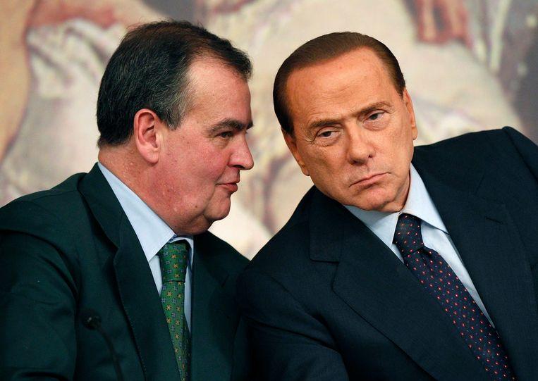 Roberto Calderoli (links) van de Lega (Nord) was  tussen 2008-2011 Italiaans minister van  Administratieve Vereenvoudiging. Premier was toen Silvio Berlusconi (archieffoto 2011).