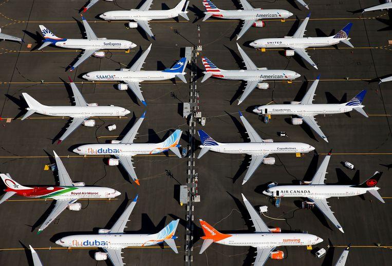 Vliegtuigen van het type Boeing 737 Max die geparkeerd staan op Boeing Field in Seattle tot ze weer de lucht in mogen.   Beeld Reuters