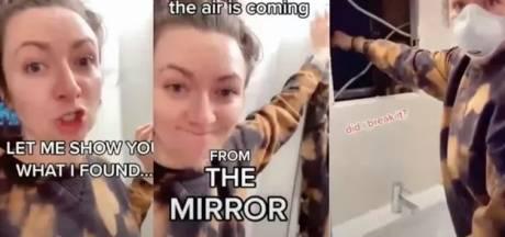 Une femme découvre un appartement caché derrière le miroir de sa salle de bain