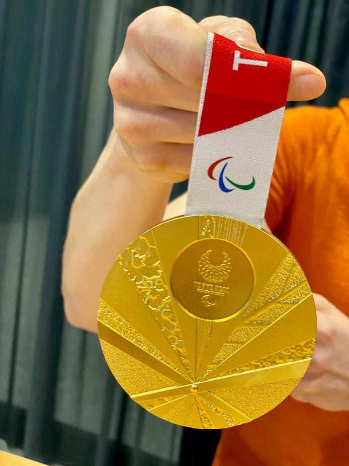 De gouden olympische plak.