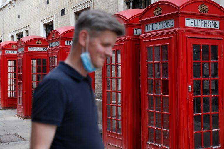 Oude telefoonhokken in Londen. Beeld Getty Images