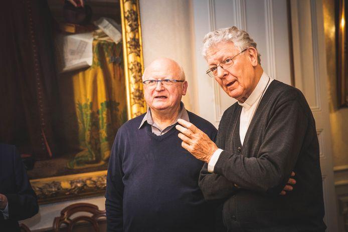 De nieuwe en de bijna-ex-bisschop van Gent, Lode Van Hecke (links) en Luc Van Looy.