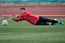Belgium's goalkeeper Thibaut Courtois dives for a ball during a training session of the national team at Petrovsky stadium in St. Petersburg, Russia, Friday, June 11, 2021, on the eve of the Euro 2020 soccer championship group B match between Russia and Belgium. The Euro 2020 gets underway on Friday June 11 and is being played in 11 host cities across 11 countries. The event was delayed by one year after being postponed in 2020 due to the COVID-19 pandemic. (AP Photo/Dmitri Lovetsky)