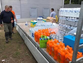 Groep vrijwilligers helpt kelders leegpompen en afval opruimen in getroffen gebied in Wallonië