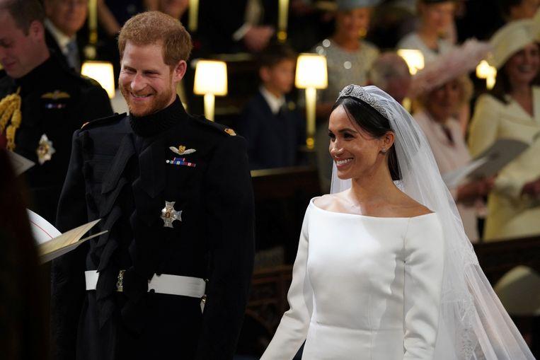 Prince Harry en Meghan Markle in de St. George's Chapel in Windsor Castle tijdens hun huwelijk. Beeld REUTERS