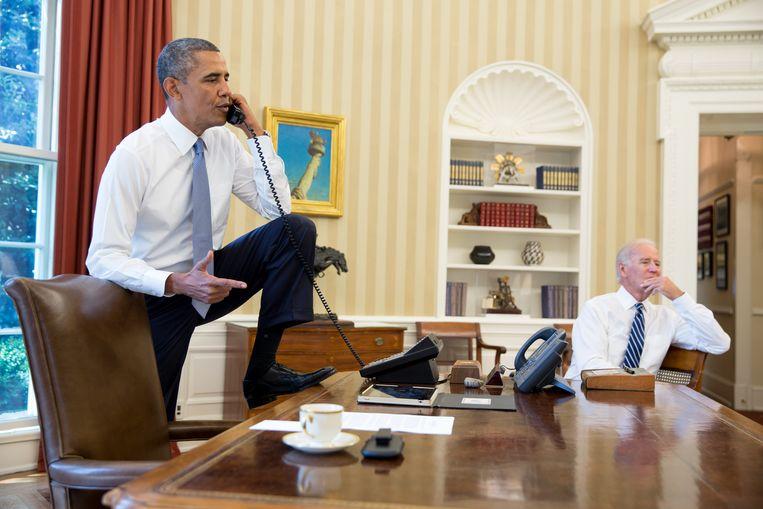 President Barack Obama in 2013 met zijn vicepresident Joe Biden.  Beeld The White House