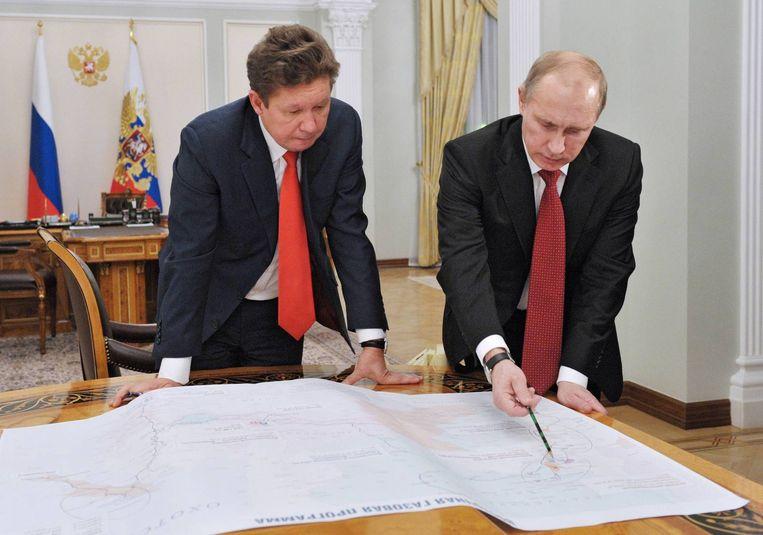 Poetin met Gazprom-topman Alexei Miller in 2012. Beeld reuters