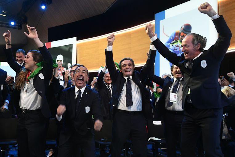 De Milaan-delegatie juicht nadat de beslissing valt.  Beeld AFP