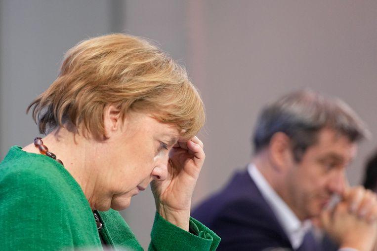 Angela Merkel maandag na afloop van haar bespreking met deelstaatleiders. Beeld AP