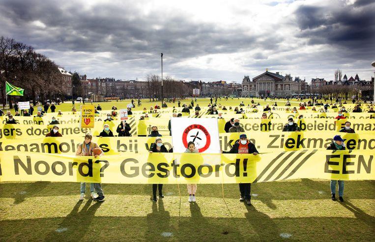 Een groep demonstranten uit Amsterdam Noord. Beeld Jean-Pierre Jans