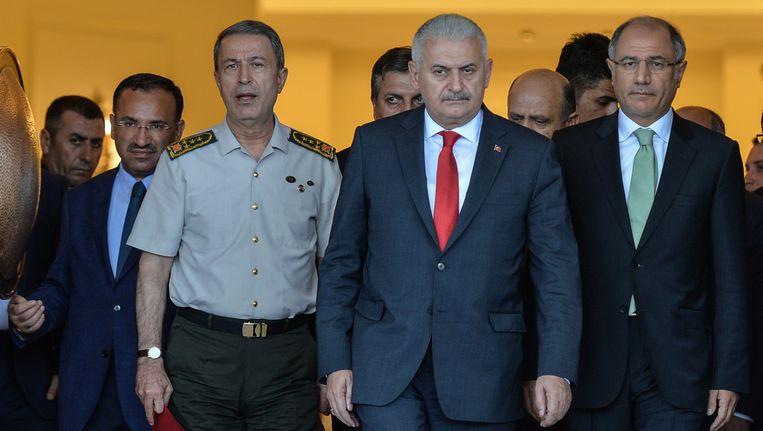 Turks justitieminister Bekir Bozdag, generaal Hulusi Akar, eerste minister Binali Yildirim en minister van Binnenlandse Zaken Efkan Ala. Beeld AP
