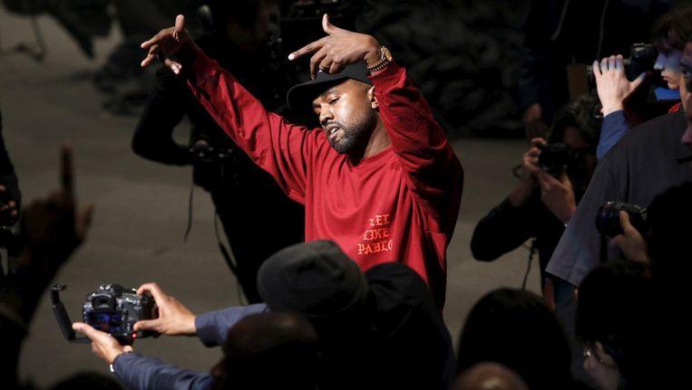Kanye West tijdens de presentatie van zijn nieuwe album en kledinglijn Beeld Reuters