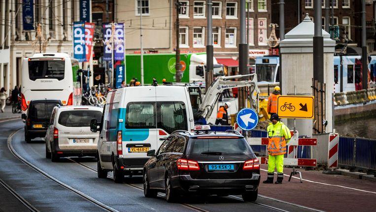De auto is de baas in Amsterdam Beeld anp