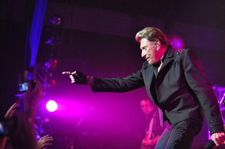 Johnny Hallyday tijdens een concert in Hollywood in 2014. Beeld Photo News