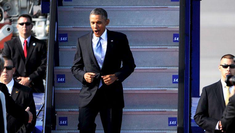 Obama loopt de trappen af van Airforce One, Beeld reuters