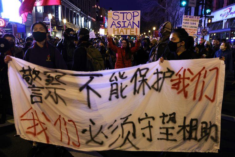 Activisten houden een mars in Washington in de nasleep van de Atlanta-shootings. Beeld Getty Images