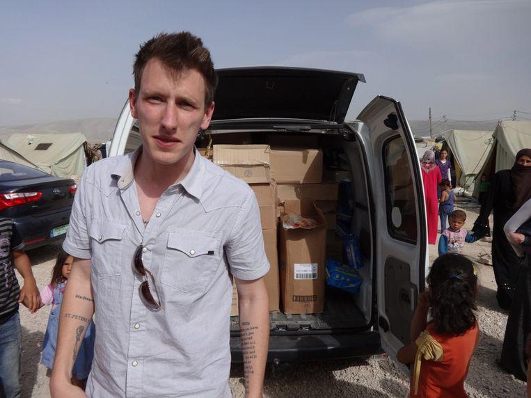 Peter Kassig op een onbekende locatie in Syrië. Beeld EPA