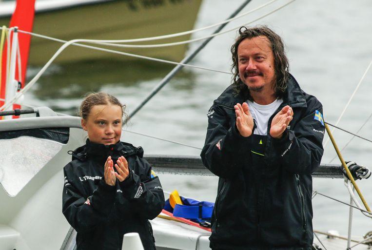 Met haar vader in augustus 2019, nadat ze de Atlantische Oceaan hebben overgevaren. Beeld AFP