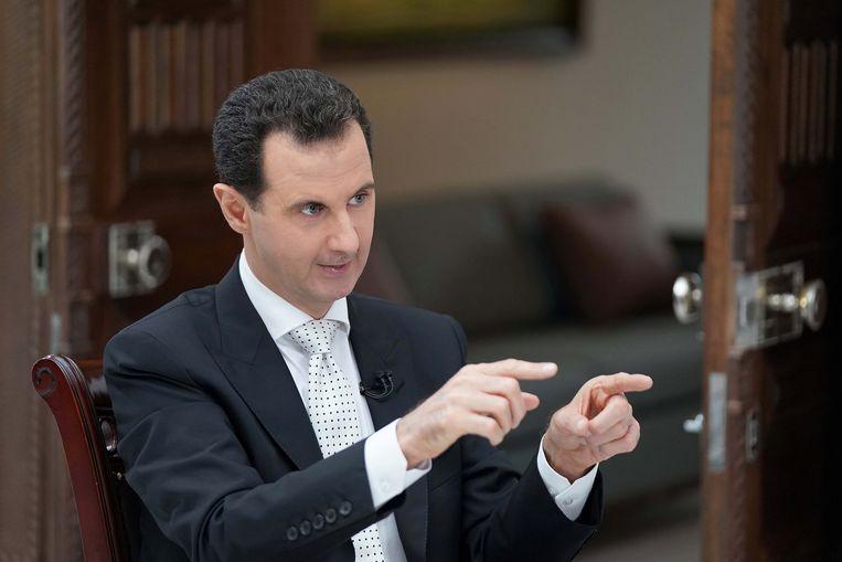 Bashar al Assad tijdens een interview met een Griekse krant in mei.  Beeld REUTERS