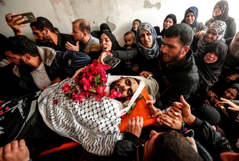 Ook deze strijder overleefde de geheime missie in de Gaza niet.  Beeld AFP