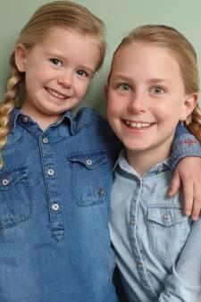Zusjes Mijke (9) en Aniek (4) spaarden twee jaar hun haren op voor pruiken voor zieke leeftijdsgenootjes