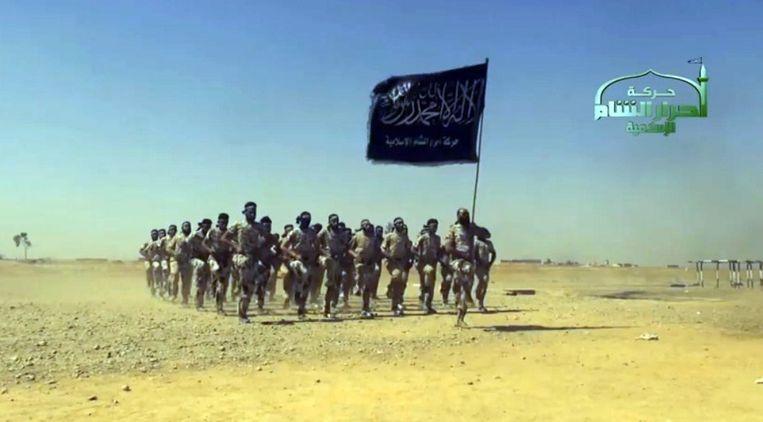 Strijders van Ahrar al-Sham tijdens een militaire training. Beeld AFP