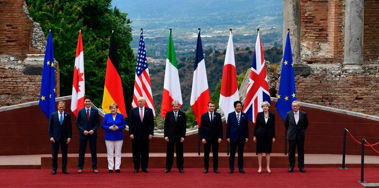 V.l.n.r.: EU-president Tusk, de Canadese premier Trudeau, de Duitse bondskanselier Merkel, de Amerikaanse president Trump, de Italiaanse premier Gentiloni, de Franse president Macron, de Japanse premier Abe, de Britse premier May en EU-Commissievoorzitter Juncker.  Beeld AFP