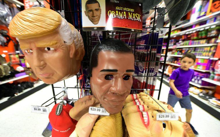 Maskers van Trump en Obama Beeld afp