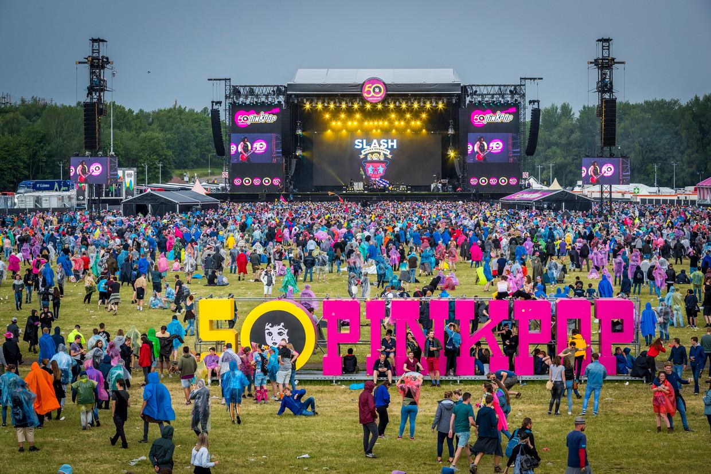 Tientallen bedrijven en duizenden mensen komen samen om een festival als Pinkpop mogelijk te maken. Beeld ANP