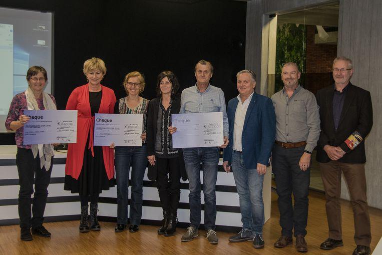 Van links naar rechts: Maria Simkens, Annemie Vanbussel, An Vandervoort, Carine Belmans, Ludo Geyskens, Francis Mertens, Marc Hamers en Roger Smeyers.
