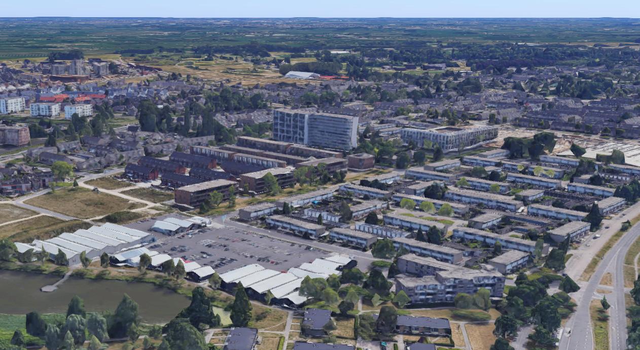 De woningen komen op het terrein dat hier nog gevuld is met de witte tijdelijke onderkomens van winkels. Rechts is de Laan van Zevenhuizen te zien.