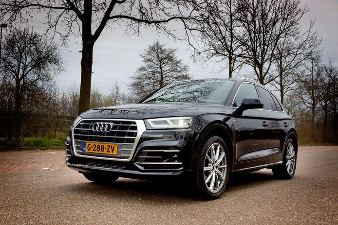 De Audi Q5 rijdt stil en comfortabel. En met de hybride motor ook best zuinig.