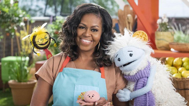 Wafeltje & Mochi, met in het midden Michelle Obama. Beeld