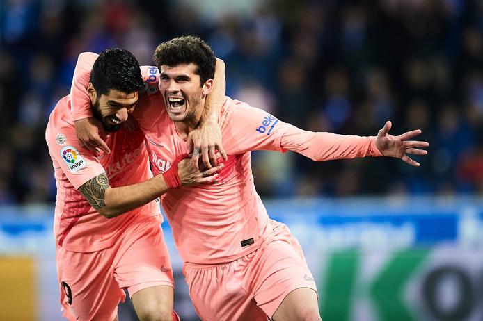 Carles Aleña (r) en Luis Suárez zijn dolblij met de 0-1.