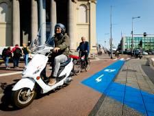 Camera's en boetes moeten scooters van het fietspad houden