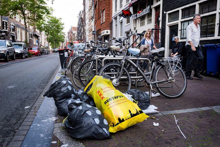 Afval in de straten van Amsterdam.  Beeld ANP