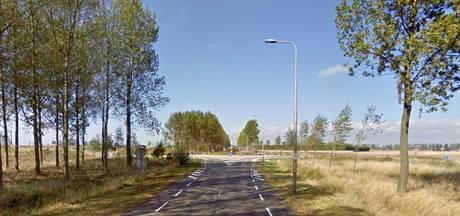 Asfaltonderhoud op de Bernhardweg-West bij 's-Heerenhoek