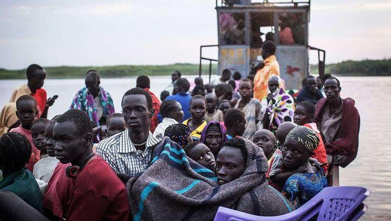 Vluchtelingen op de Witte Nijl op 9 januari. Beeld afp