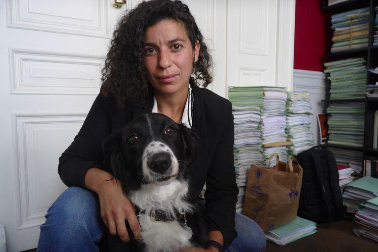 Sophie Dewulf en haar hond. Beeld BELGA