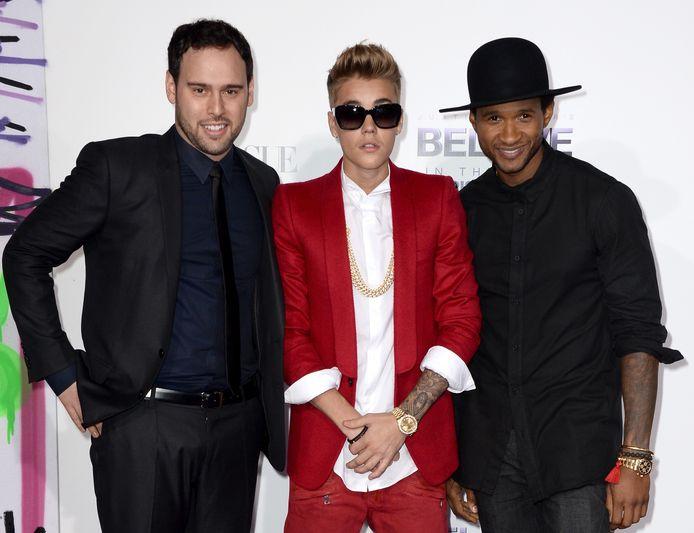 Scooter Braun (links) met Justin Bieber en Usher in 2014