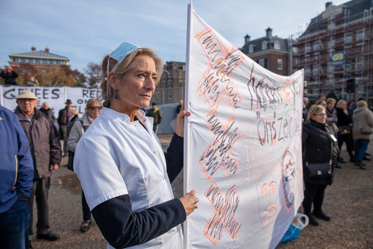 Demonstranten zondag op het Museumplein in Amsterdam. Beeld Harry Cock / de Volkskrant