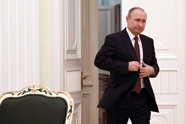 President Vladimir Poetin vorige week maandag, een dag na de door hem gewonnen verkiezingen  Beeld EPA