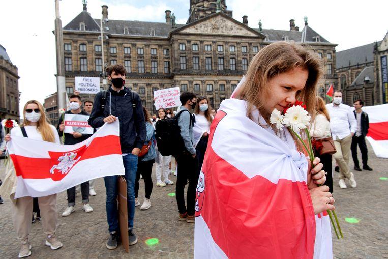 Demonstranten op de Dam tijdens een protest van Open Belarus. Beeld Hollandse Hoogte /  ANP