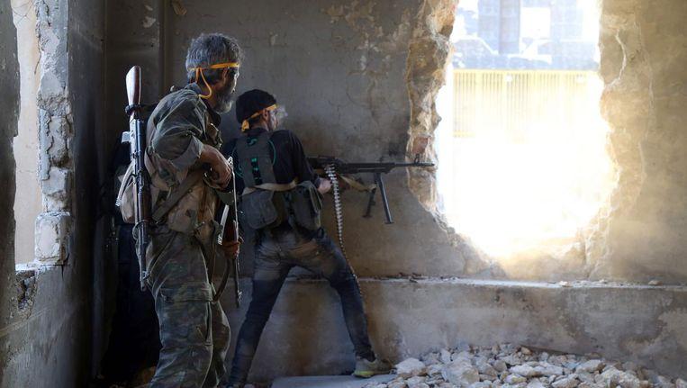 Syrische rebellen in Ramussa ten zuidwesten van Aleppo. Beeld afp