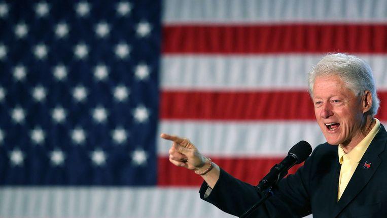Bill Clinton op campagne voor zijn vrouw Hillary. Beeld AFP