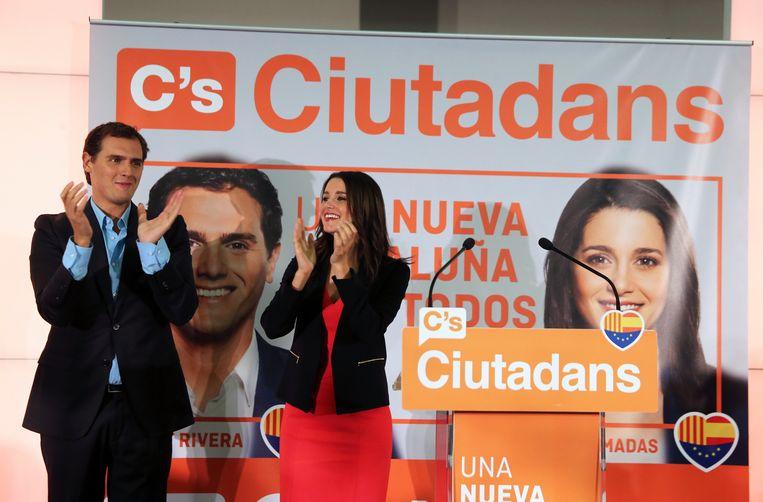 Ciudadanos-voorzitter Albert Rivera en Catalaans kopstuk Ines Arrimadas hadden gisteren alle reden tot vieren. Hun partij steeg van 9 tot 25 zetels. Beeld AFP